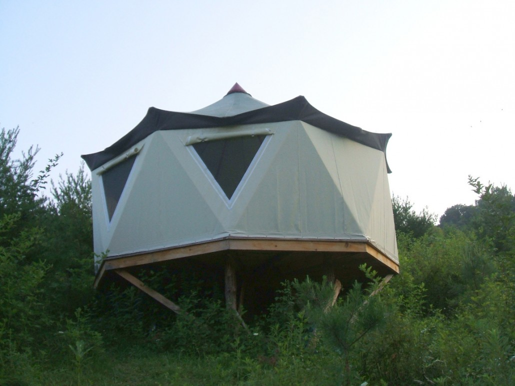 Dramatic view from down slope of a grand yurt style Yome home tent structure