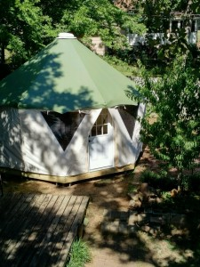 A smartly built Yome tent structure on a deck makes a backyard play house