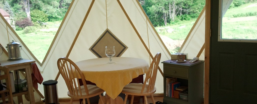 Dining area in a well kept tent home hybrid of tipi, yurt and dome